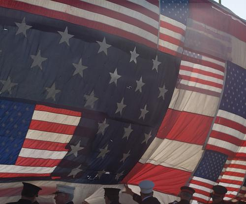 The National 9/11 Flag is unveiled at the Kennedy Space Center in February. Survivors of the Joplin tornado put the final stitches in the flag over the weekend.