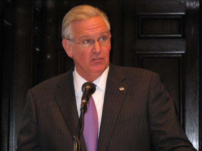 Mo. Gov. Jay Nixon (D) talks with reporters at a press conference at the State Capitol.