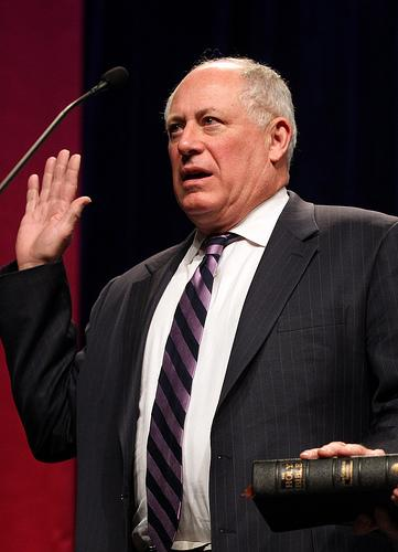 Ill. Gov. Pat Quinn, shown here taking the oath of office, has announced plans to lay off 1,900 workers and close seven state facilities as part of an ongoing budget battle with lawmakers.