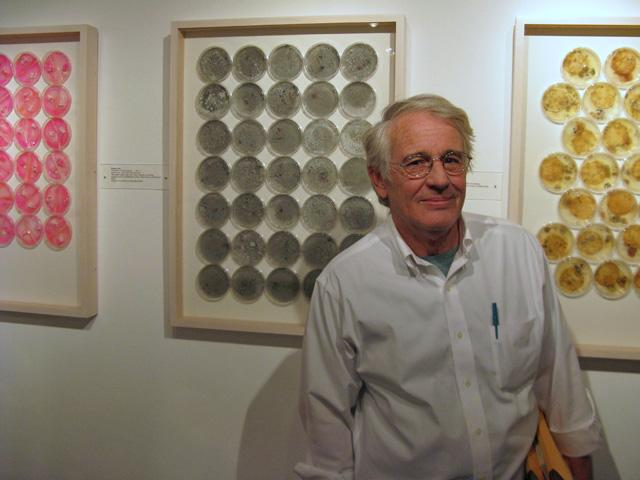 "Ronald Leax with works in his ""The History of Culture Series,"" 2011, which is an homage to great microbiologists from the 17th century to the present day."