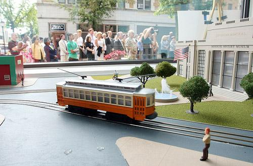 A model trolley car whizzes by in a window display at the Blueberry Hill Restaurant during a ceremony to announce that the St. Louis area received nearly $25 million in federal dollars for a new trolley system in University City, Mo. on July 9, 2011.