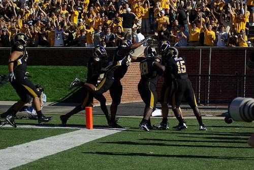 Univ. of Missouri football players celebrate after a touchdown during a 2007 game against Texas Tech. The system's Board of Curators on Tuesday authorized Chancellor Brady Deaton to consider moving Mizzou from the Big 12 to another conference.