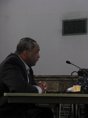 Charles Bryson testifies under oath in front of the Public Safety Committee of the Board of Aldermen on Oct. 17, 2011.