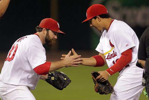 St. Louis Cardinals pitcher Jason Motte (L) and Jon Jay celebrate a 4-3 win over the Milwaukee Brewers in Game 3 in the NLCS at Busch Stadium in St. Louis on October 12, 2011.