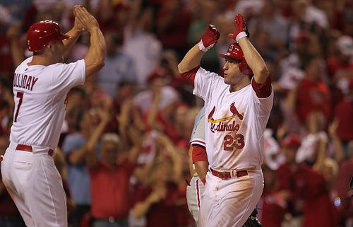 David Freese (R) celebrates his 6th inning two-run home run with Matt Holliday (L) on Oct. 5. Freese drove in four of the Cardinals' five runs in a 5-3 victory over the Philadelphia Phillies in game 4 of the NL Division Series.