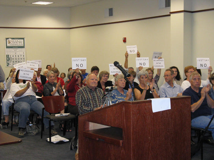Franklin County residents hold up signs to show their opposition to Ameren's landfill plans at a meeting of the county commission in 2011, just before the commission voted to change its zoning regulations to allow coal ash landfills.