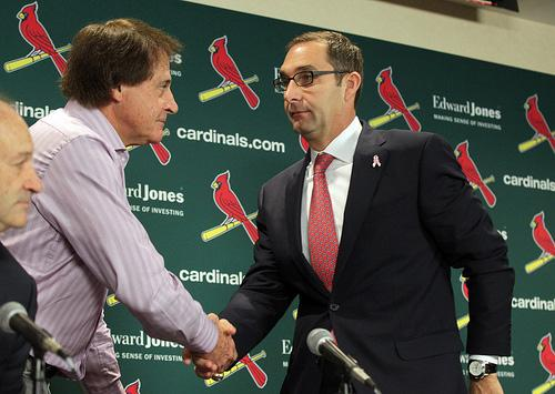 St. Louis Cardinals General Manager John Mozeliak (R) shakes the hand of manager Tony La Russa after La Russa announced his retirement during a press conference at Busch Stadium in St. Louis on Oct. 31, 2011.