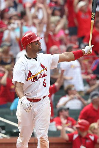 Albert Pujols had one of the biggest postseason nights of his career in Game 2 of the NLCS going 4 for 5 with a home run, three doubles, and five RBIs. He's shown here hitting a game winning home run against the Chicago Cubs on June 5, 2011.