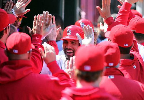 St. Louis Cardinals' Albert Pujols enters the dugout after hitting a two run home run in the eighth inning against the Washington Nationals at Busch Stadium on April 21, 2011. Last night, Pujols hit a go ahead single to edge the Phillies 5-4.