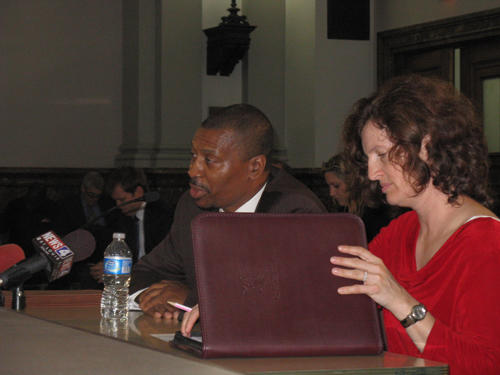A Tuesday hearing of the public safety committee was the first time suspended corrections commissioner Gene Stubblefield (L) answered questions about recent jail breaks. His attorney, Sherrie Schroder, is at right.