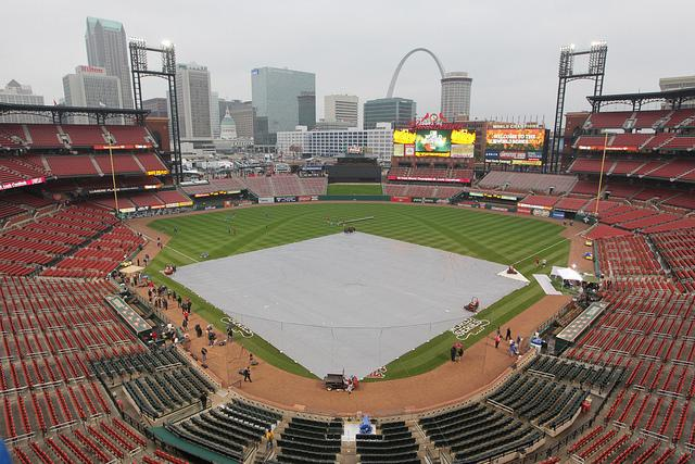 A tarp covers the Busch Stadium infield after it was announced that Game 6 of the 2011 World Series between the Texas Rangers and the St. Louis Cardinals has been postponed due to possibilities of heavy rain in St. Louis on Oct. 26, 2011.