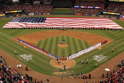 An oversized American flag covers the Busch Stadium outfield during the playing of the National Anthem before Game 1 of the 2011 World Series between the Texas Rangers and the St. Louis Cardinals in St. Louis on Oct. 19, 2011.