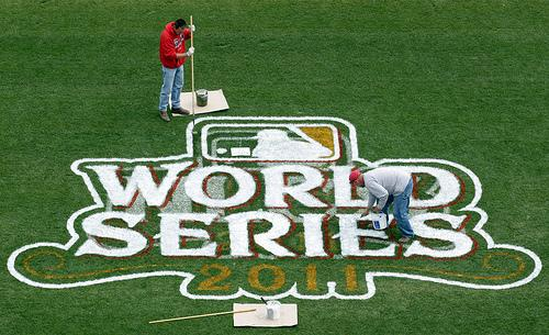 A painting crew from the Warren Sign Company puts the finishing touches on the World Series logo at Busch Stadium in St. Louis on October 17, 2011. The St. Louis Cardinals will host the Texas Rangers in Game 1 of the 2011 World Series on October 19, 2011.