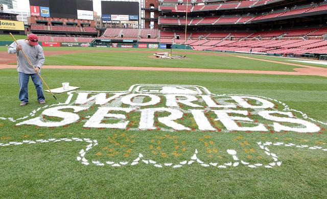Painter Brad Juelfs from the Warren Sign Company rolls on the World Series logo at Busch Stadium in St. Louis on October 17, 2011.