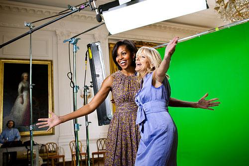 First Lady Michelle Obama and Dr. Jill Biden joke together while taping a Joining Forces public service announcement in the East Room of the White House, April 4, 2011. Obama and Biden will attend the first game of the 2011 World Series in St. Louis.