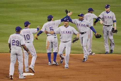Members of the Texas Rangers celebrates after defeating the St. Louis Cardinals 2-1 to take game 2 of the World Series in St. Louis on October 20, 2011. The series stands tied 1-1.