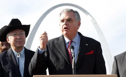 Secretary of the Interior Ken Salazar (L) looks on as Transportation Secretary Ray LaHood explains plans for changes to the Jefferson National Expansion Memorial where the Gateway Arch sits, during a press conference in East St. Louis in Dec. 2010.