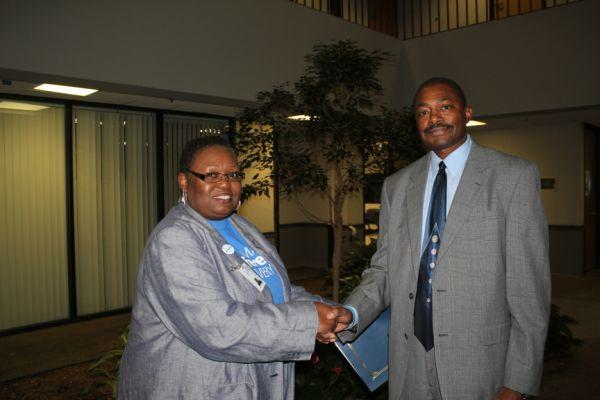Union president Mary Armstrong and SLPS superintendent Kelvin Adams shake hands after the approval of a new three-year contract for district employees that includes the first raises in three years.