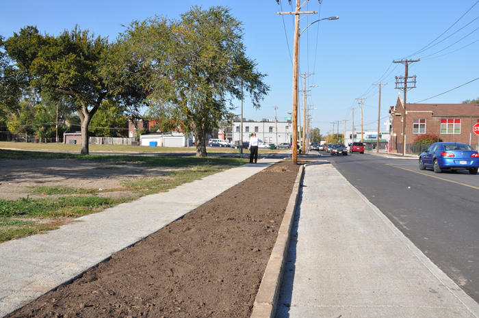 "Along N. Sarah Street south of Page Ave., the sidewalks and parking lanes are paved with porous concrete as part of a ""green infrastructure"" demonstration project."