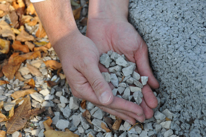 The layer of porous concrete is about four to six inches thick with about 12 to 18 inches of gravel underneath it, to slow the flow of water into the sewer system.
