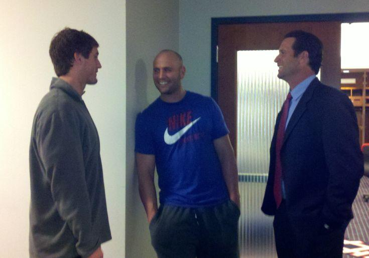Cardinals players David Freese (L) and Matt Holliday (C) chat with their new manager, Mike Matheny.