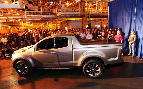 Workers at the GM Wentzville plant get the first look at the Chevy Colorado, which will be produced at their facility starting sometime next year thanks to a $380 million expansion.