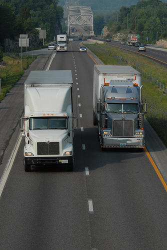Two trucks travel in the east-bound lanes of I-70 between Columbia and Boonville, Mo.