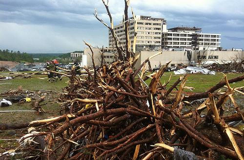 Tree limbs are piled up near Saint John's Hospital in Joplin, Missouri on May 22, 2011. Officials say a deadly tornado cut a path a mile wide by four miles, destroying over 2000 homes and businesses. 116 people have died so far.