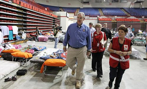 Missouri Governor Jay Nixon is given a tour of the Black River Coliseum by Red Cross volunteers in Poplar Bluff, Missouri on April 26, 2011. A levee on the Black River protecting the area from major flooding breached in several places.