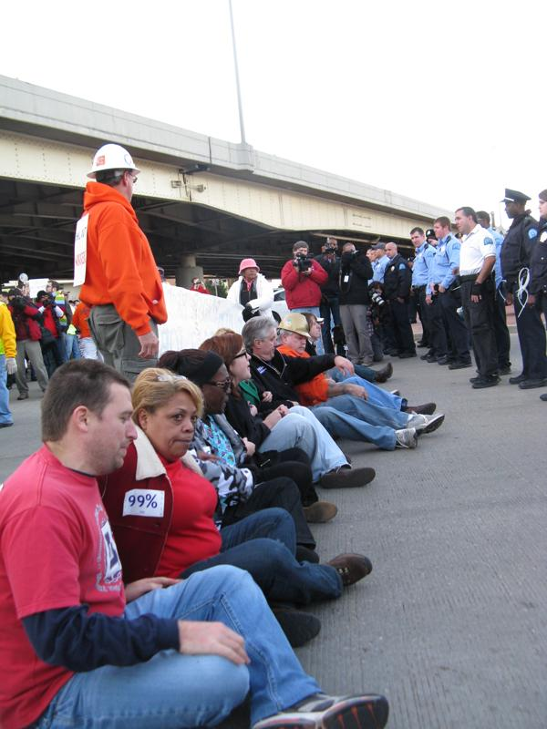 Occupy St. Louis protesters sit together at the entrance of the Martin Luther King bridge in St. Louis on Nov. 17, 2011.