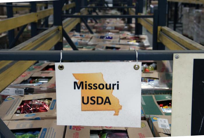 A rack of US Department of Agriculture bonus commodities is empty at the Saint Louis Area Food Bank's warehouse in Earth City.
