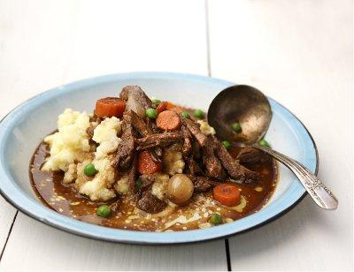 Stout-braised short ribs with creamy mashed potatoes. (Photo by Carmen Troesser, courtesy Sauce Magazine.)
