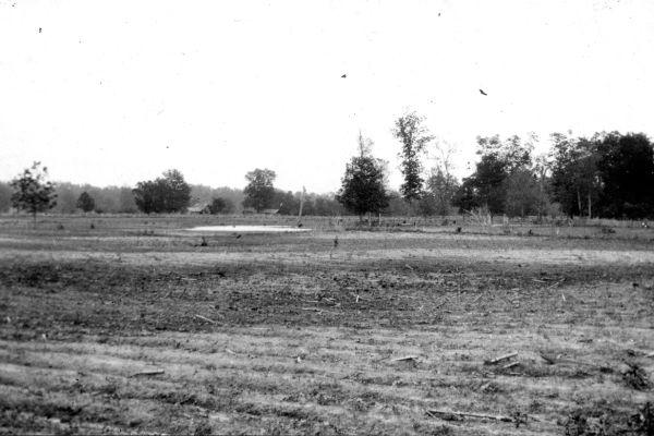 Caption: This photo, taken in Blytheville, Missouri, in 1904, shows sand blows (lighter patches) resulting from the New Madrid earthquakes.