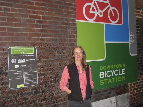 "Trailnet executive director Anne Mack stands outside the downtown bike commuter station, one of the main reasons she calls 2011 ""A Good Year"" for bikes."