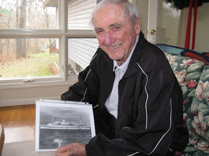 Bill McAnany of Jefferson City holds a photo of the USS Solace, the hospital ship he was assigned to when the Japanese attacked Pearl Harbor on Dec. 7th, 1941.