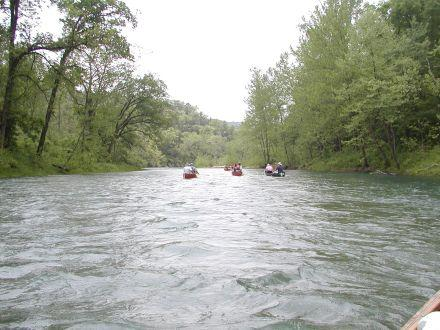 Canoes float down the Current River.