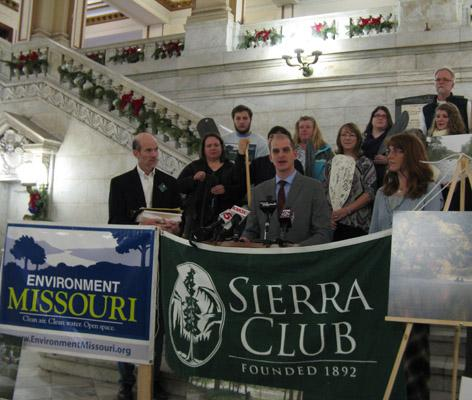 Ted Mathys, state advocate for Environment Missouri (at podium) and other environmentalists urged the National Park Service to protect the Current River in Missouri during a press conference at St. Louis' City Hall on Dec. 13, 2011.