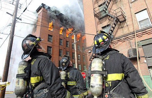 St. Louis firefighters check an adjoining building during a five-alarm fire in downtown St. Louis on Dec. 8, 2011. The six story, vacant building is a complete loss as 125 firefighters fought the stubborn blaze for five hours.