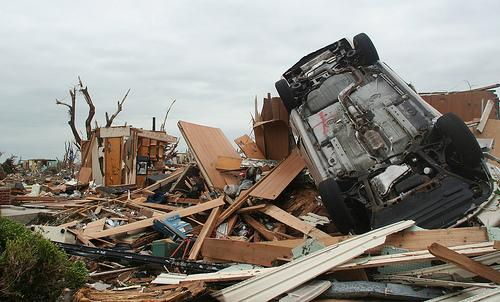 An overturned car sits where a house once stood in Joplin, Mo. on May 24, 2011.  The Associated Press has named the Joplin tornado the top story of 2011.