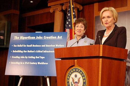 Sens. Claire McCaskill, D-Mo. (at right) and Susan Collins, R-Maine announce their legislation to cut payroll taxes, boost transportation funding and restrict regulation.