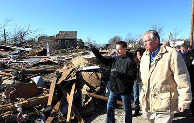 Mo. Gov. Jay Nixon walks with resident Anthony Tumminia during a tour of tornado damage in Sunset Hills, Mo. on Jan. 1, 2011. Sunset Hills sustained damage to about 25 homes in a storm Dec. 31, 2010. Tumminia'a home was completely destroyed.