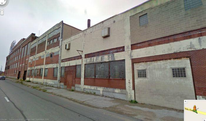 This Google Maps screen capture looking east on Chouteau Ave. shows the old milk plant and office building of Pevely Dairy. The city approved a proposal that will allow SLU to tear down the milk plant - the office building would remain.