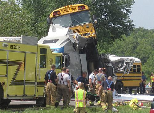 Firefighters work a school bus accident that killed two and injured 38 others in a chain reaction accident near Gray Summit, Mo. on Aug. 5, 2010. It has since been reported that the driver in the initial collision of the pileup was texting while driving.