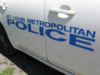 The side of a St. Louis Metropolitan Police patrol vehicle.