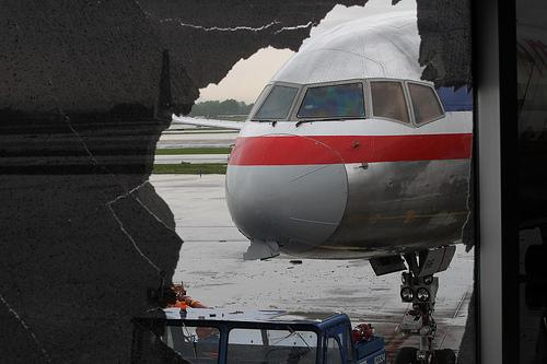 Damage to the nose of an American Airlines plane can be seen through a shattered window in the C concourse at Lambert-St. Louis International Airport in St. Louis on April 23, 2011.