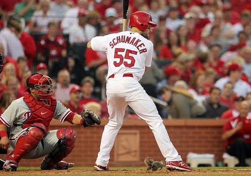 A squirrel runs through the legs of St. Louis Cardinal Skip Schumaker while he bats in the fifth inning during Game 4 of the NLDS against the Philadelphia Phillies at Busch Stadium in St. Louis on Oct. 5, 2011.