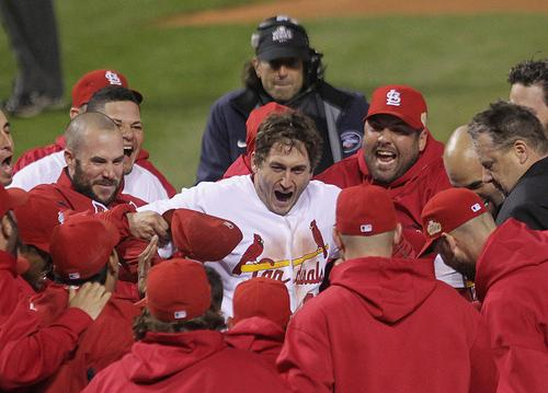 St. Louis Cardinals David Freese celebrates with his teammates at home place after hitting a solo walk off homerun to win game 6 of the World Series in the 11th inning on Oct. 27, 2011. The Cardinals went on to win the series.