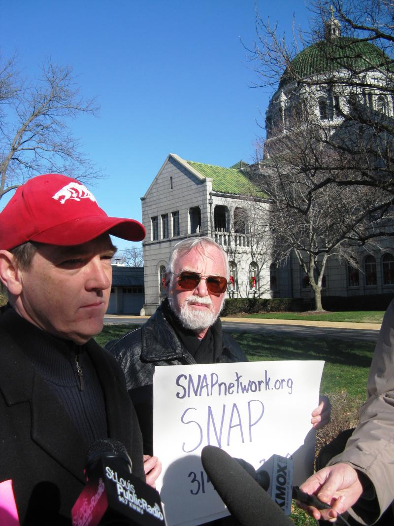 David Clohessy (left) speaking Tuesday in front of the Cathedral Basilica of St. Louis.