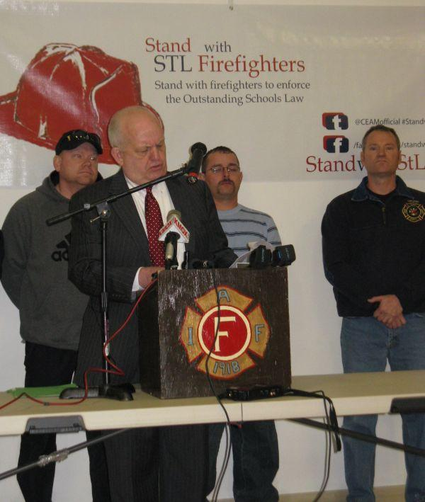 Attorney Tim Belz  takes questions on a lawsuit filed on behalf of five city firefighters, including Mike Killingsworth (L) and Shawn Ryan (R), who want three suburban districts and the SLPS to follow a state Supreme Court ruling on student transfers.