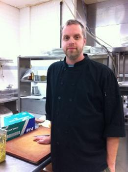 Chef Brian Hardesty in the kitchen at Root.